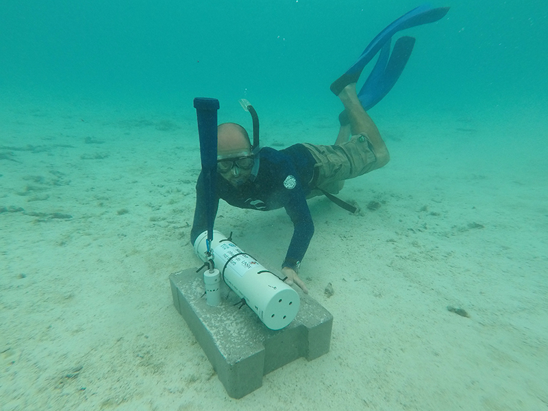 Matt Blacka installing a wave, infragravity surge, water level and current monitoring station in Muri Lagoon, Cook Islands