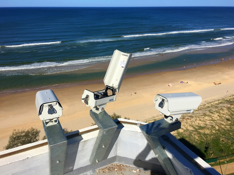 Cameras being installed on top of a building at Broadbeach on the Gold Coast