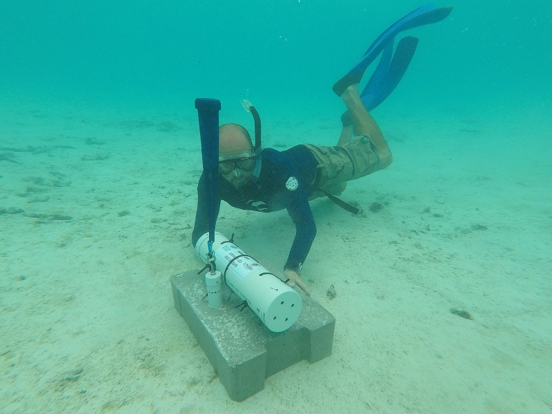 Matt Blacka installing a wave, infragravity surge, water level and current monitoring station in Muri Lagoon