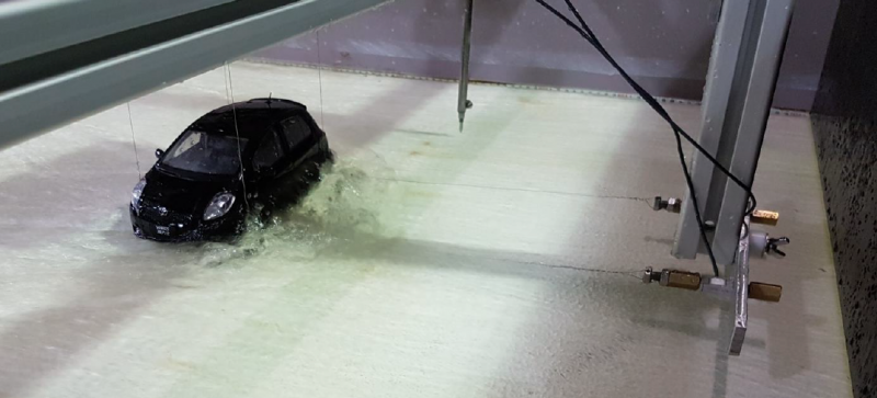 A scale physical model of a Toyota Yaris being tested in WRL's 1 m tilting flume