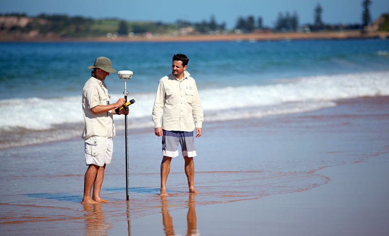 Dr Mitchell Harley (right) supervising a beach survey