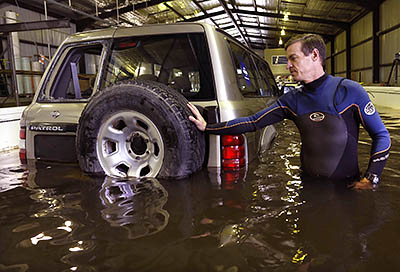 Grantley Smith testing how easily cars can be moved in floodwater