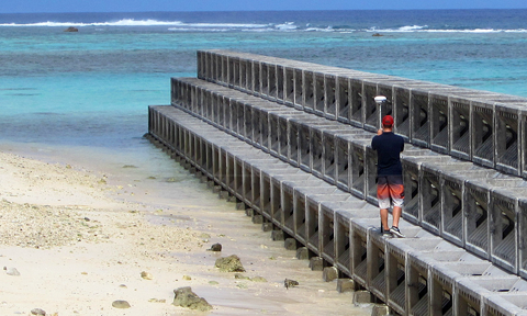 Duncan Rayner surveying the COPED break wall, Rarotonga, Cook Islands